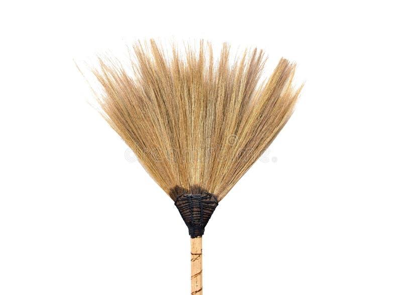 Zbliżenie odizolowywający na białym tle słomiany broomstick fotografia royalty free