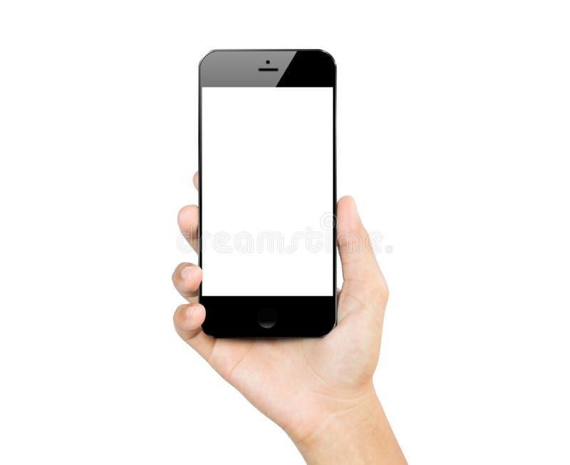 Zbliżenie ręki chwyta smartphone wisząca ozdoba odizolowywająca obraz royalty free