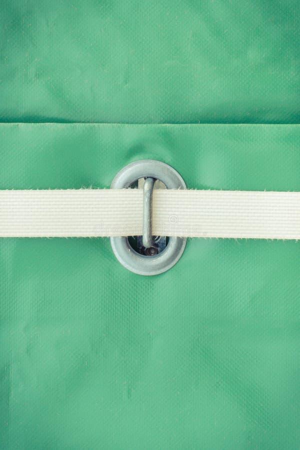 Zbliżenie robić wodoodporny materiał z arkaną jak szczegół ciężarówka zielony brezent obrazy stock
