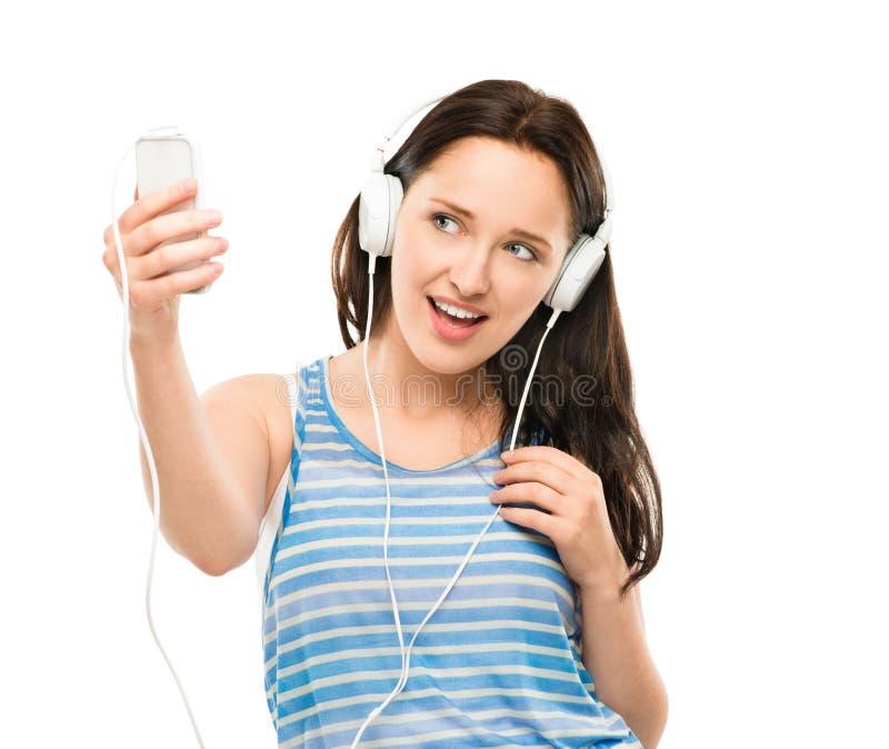 Zbliżenie szczęśliwej młodej kobiety wideo przesyłanie wiadomości odizolowywająca na bielu plecy obrazy royalty free