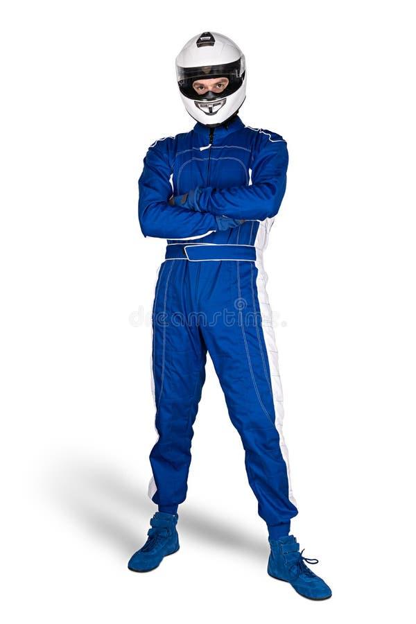 Zdecydowany biegowy kierowca w błękitnym białym motorsport kombinezonie kuje rękawiczki i całkowego zbawczego trzaska hełma odizo zdjęcie stock