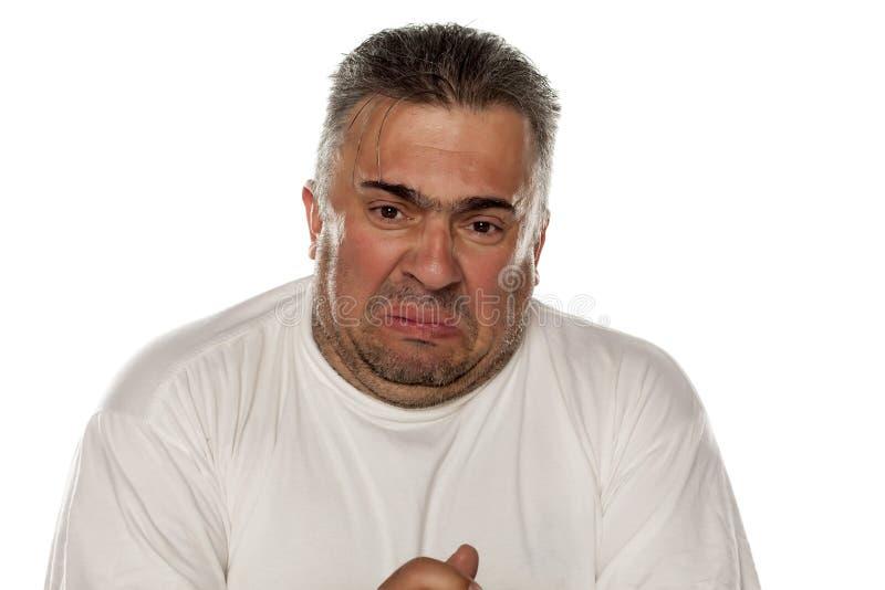Zdegustowany gruby mężczyzna fotografia stock