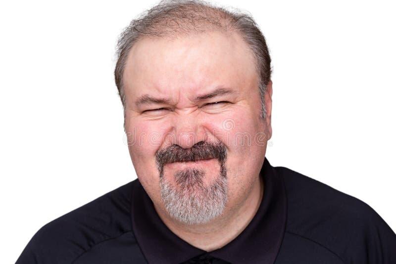 Zdegustowany mężczyzna ciągnie disdainful wyrażenie fotografia royalty free