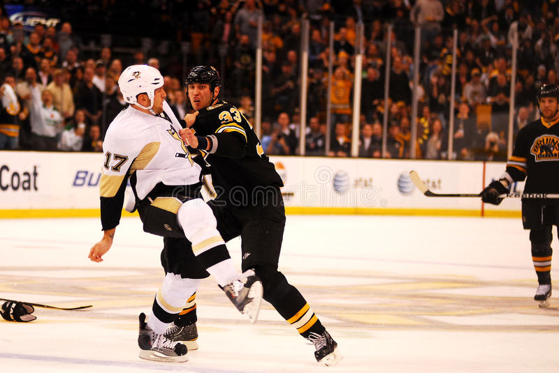 Zdeno Chara and Michael Rupp battle. Boston Bruins Captain Zdeno Chara (33) is about to take a shot at Pittsburgh Penguins Michael Rupp (17 royalty free stock photos