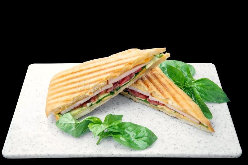 Zdrowa Piec na grillu basil mozzarelli Caprese Panini kanapki biała deska odizolowywająca Klasyczny Włoski fast food fotografia royalty free