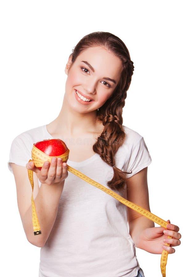 Zdrowa szczęśliwa kobieta z jabłka i taśmy miarą zdjęcia royalty free