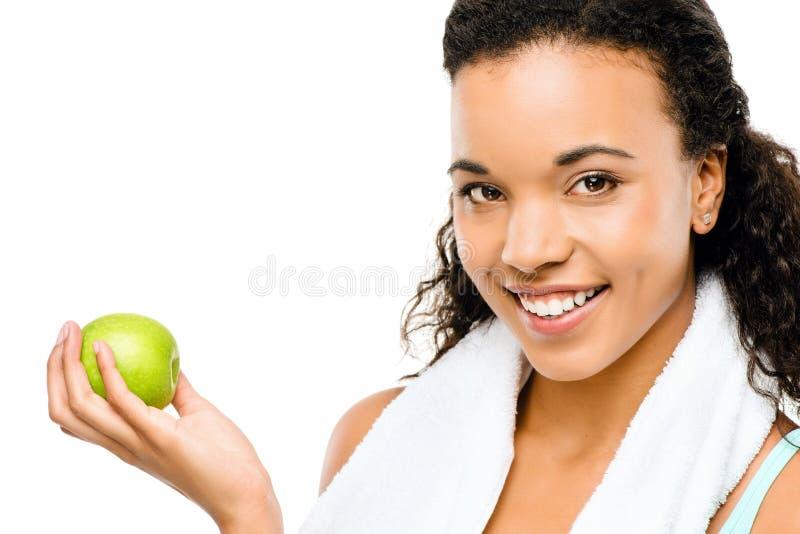 Zdrowi potomstwa mieszający biegowy kobiety mienie zielenieje jabłka zdjęcie stock