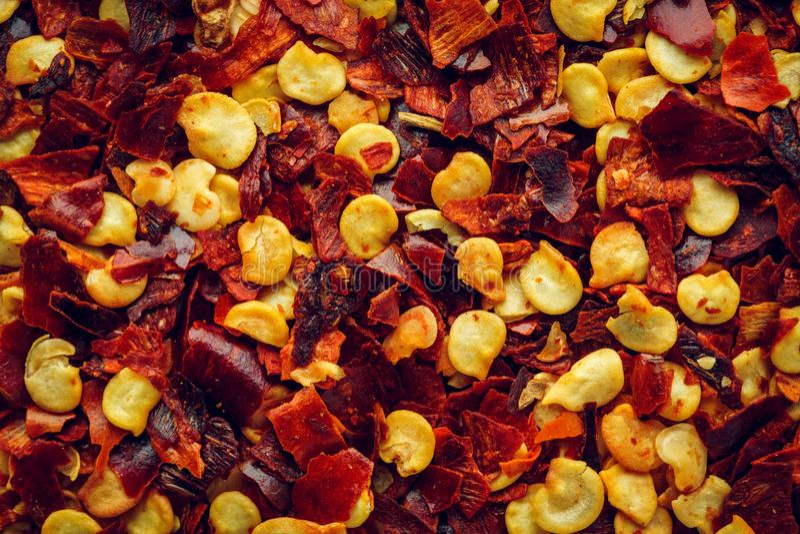 Zdruzgotany czerwony chili pieprzu makro- tło obrazy stock