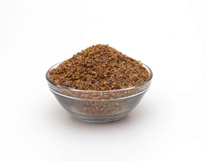 Zdruzgotany flaxseed odizolowywający fotografia stock