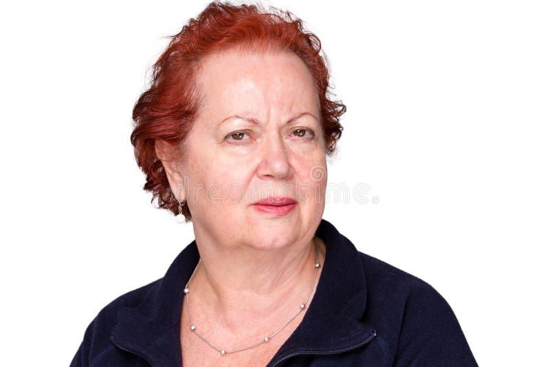 Zdumiona starsza dama z intryguję marszczy brwi obrazy royalty free