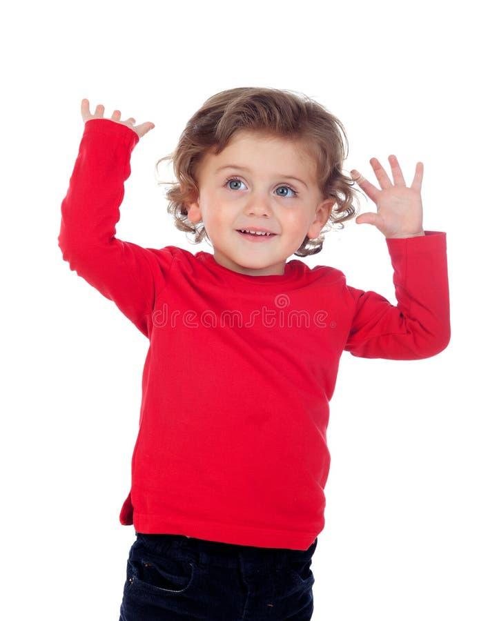 Zdziwiony dziecko z jego wręcza nastroszonego zdjęcie stock