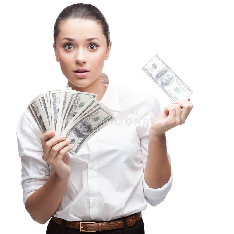 Zdziwiony młody biznesowej kobiety mienia pieniądze fotografia stock