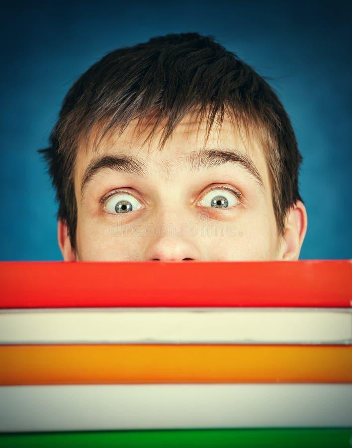 Zdziwiony uczeń z książkami zdjęcie stock