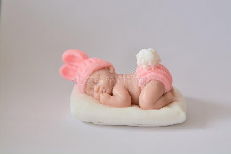 Zeepgift in de vorm van een pasgeboren babymeisje stock foto's