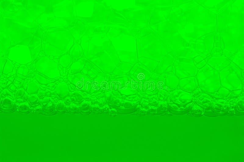 Zeepschuim en bellenachtergrond stock foto's