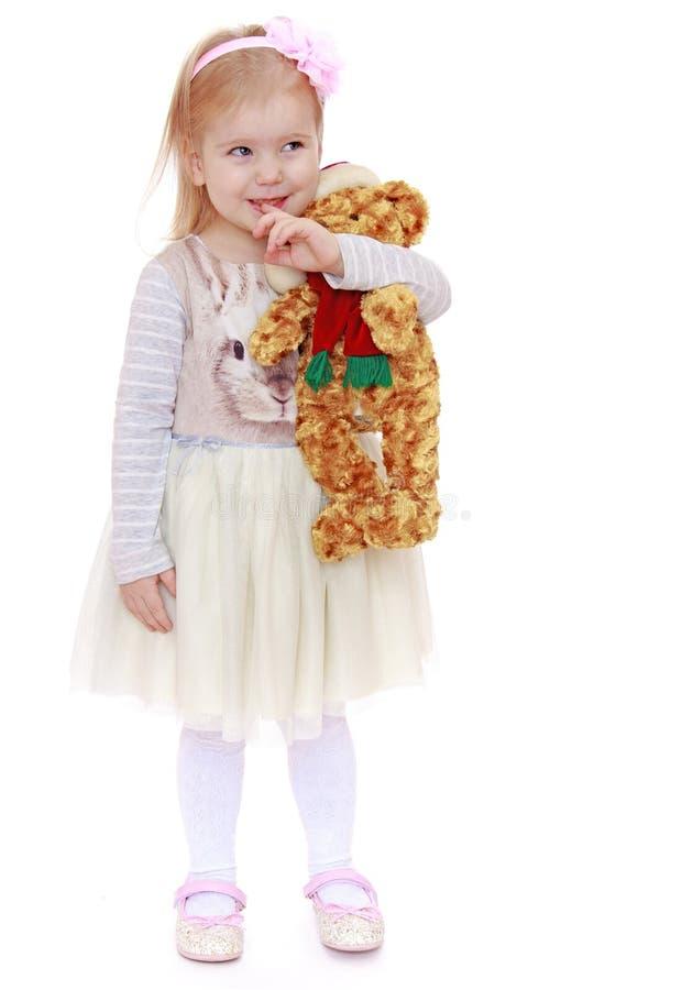 Zeer weinig blond Kaukasisch meisje kleedde zich in a stock fotografie