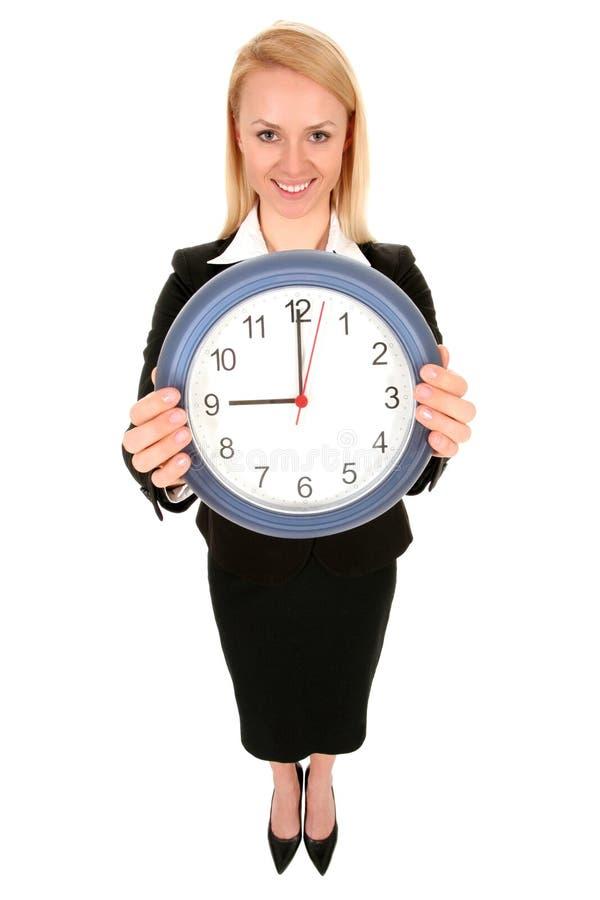 zegar bizneswomanu gospodarstwa obrazy royalty free