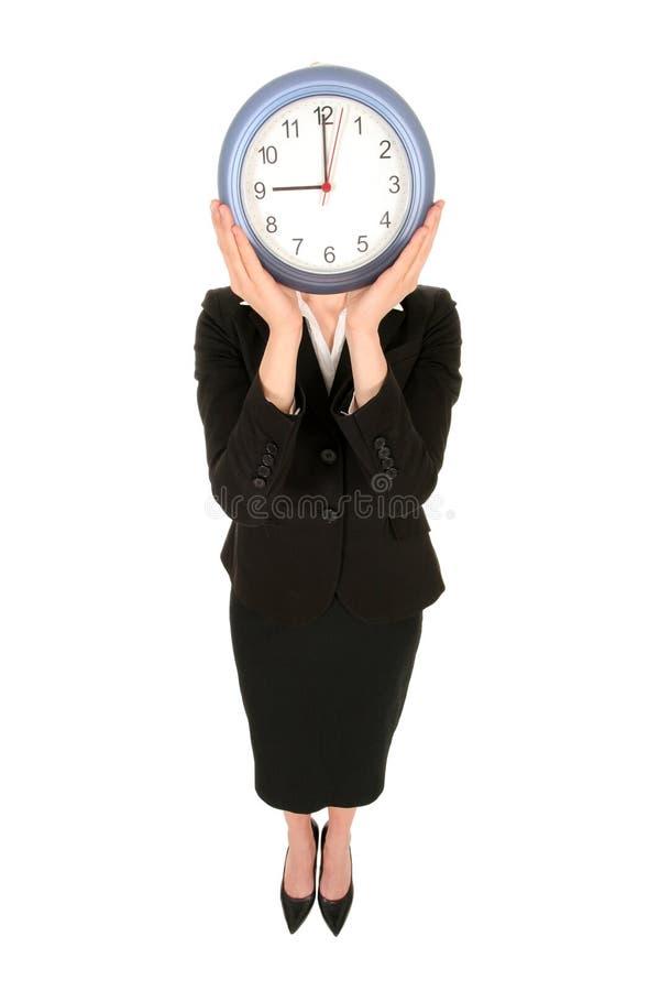zegar bizneswomanu gospodarstwa obraz stock