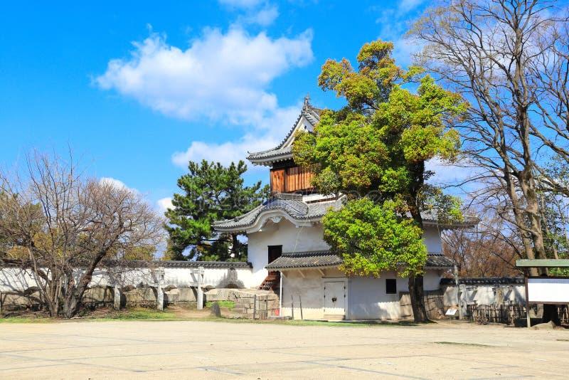 Zegarka wierza w Okayama kasztelu krukach Roszuje, czerń kasztel, Okayama, Japonia zdjęcie stock