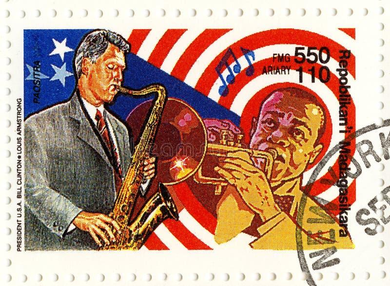 Zegel Bill Clinton en Louis Armstrong royalty-vrije stock foto