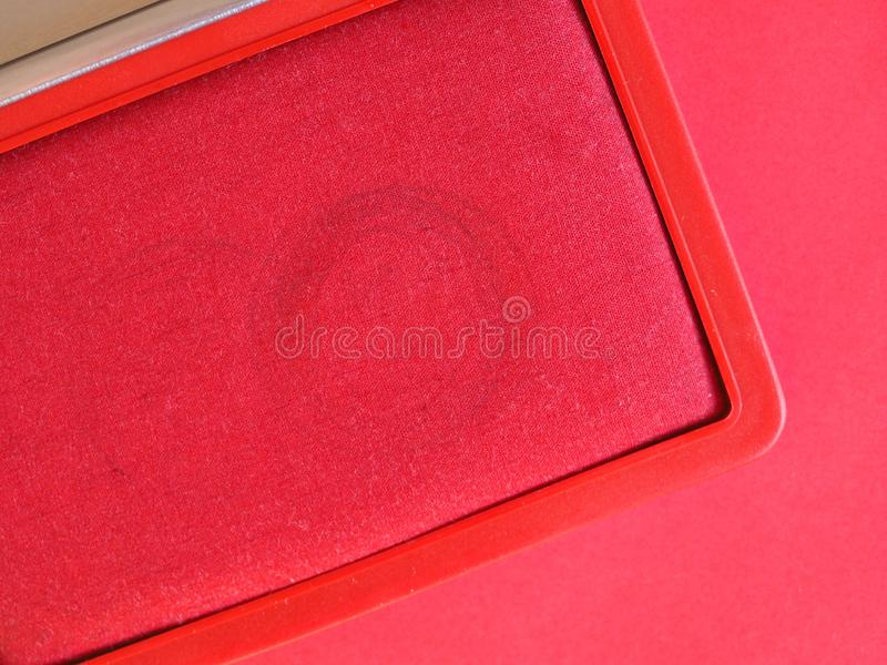 zegelstootkussen met rode inkt royalty-vrije stock afbeelding