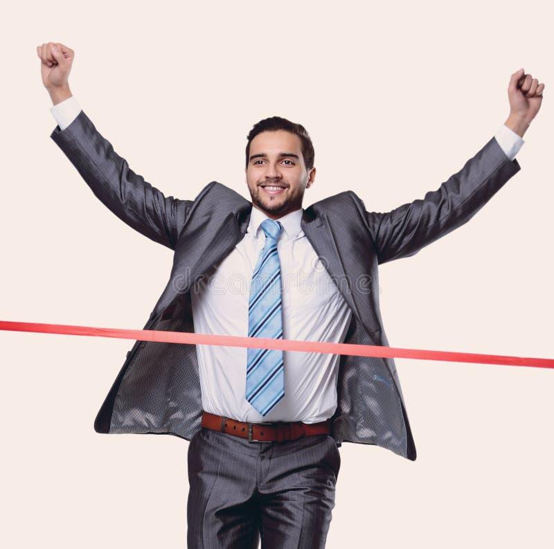Zegevierend zakenman voor de beginnende band stock foto's