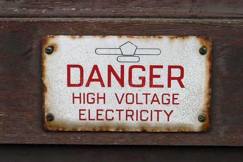 Zeichen, Gefahr Hochspg-Elektrizität Stockfotos