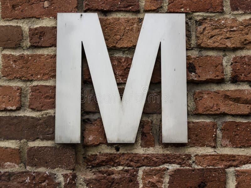 Zeichen M lizenzfreie stockfotos