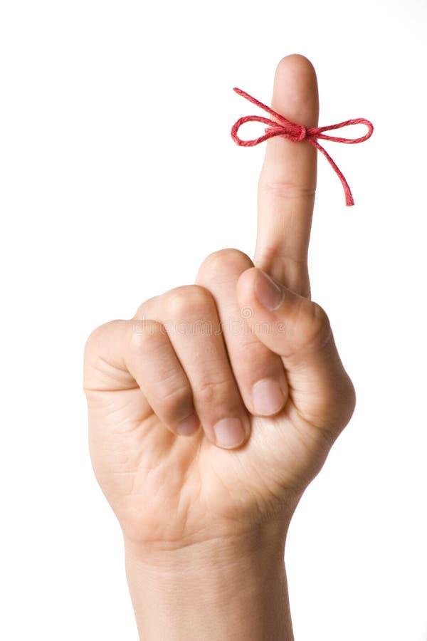 Zeichenkette-Finger-Anzeige auf Weiß stockfoto