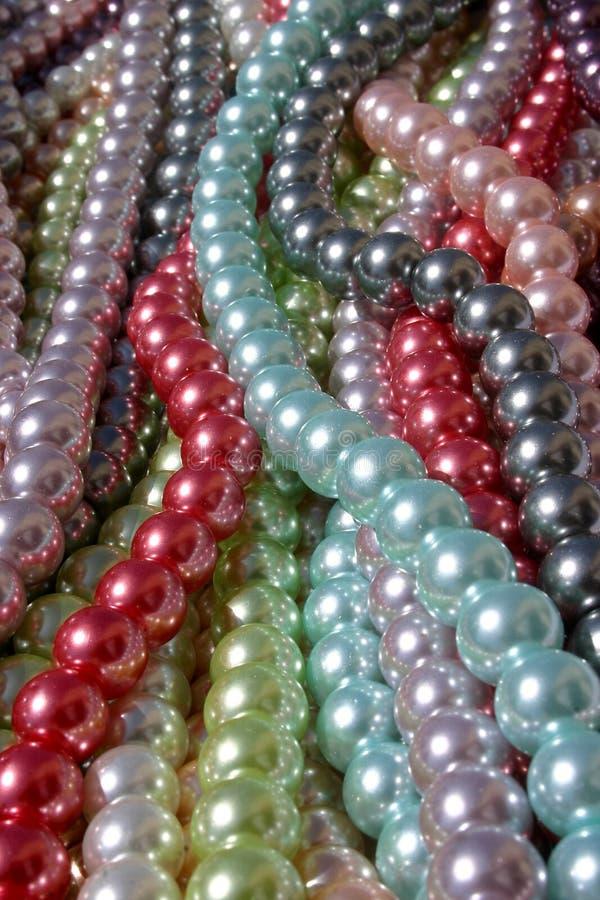 Zeichenketten der Perlen lizenzfreie stockbilder