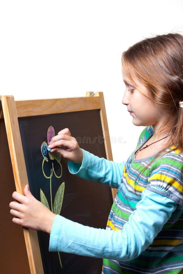 Zeichnen auf ein hölzernes Gestell stockbild