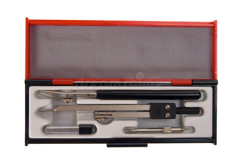 Zeichnenkompaß und Werkzeugkasten getrennt lizenzfreies stockbild