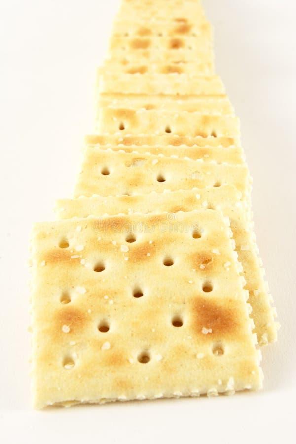 Zeile der Cracker lizenzfreie stockbilder