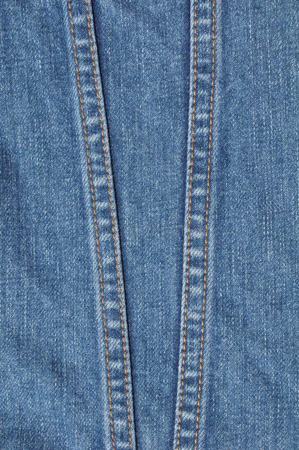 Zeile zwei auf blauem Baumwollstoff stockfotografie