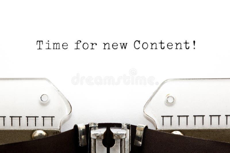 Zeit für neue zufriedene Schreibmaschine stockbilder
