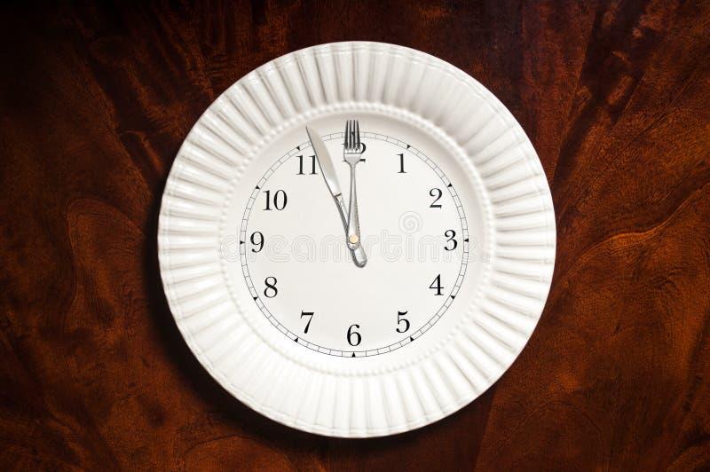 Zeit, Plattenuhr zu essen stockfoto