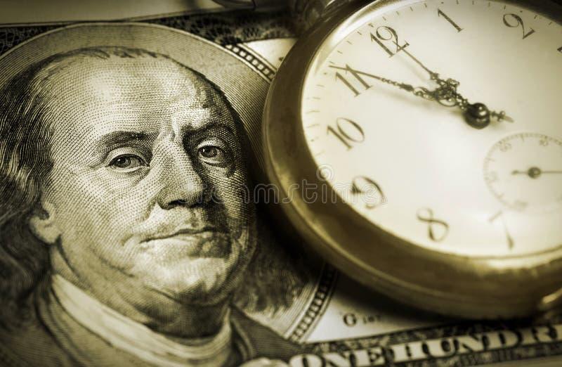 Zeit und Geld lizenzfreie stockbilder