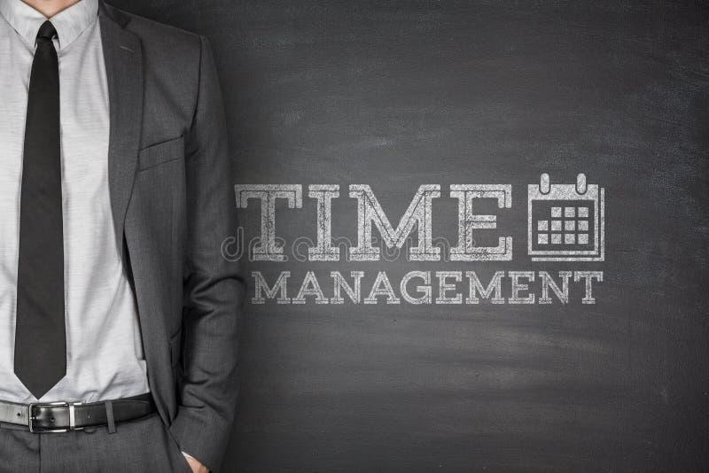 Zeitmanagement auf Tafel stockbilder