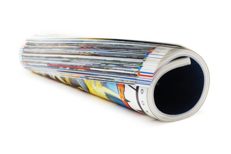 Zeitschriften-Rolle (getrennt auf Weiß) stockfotos