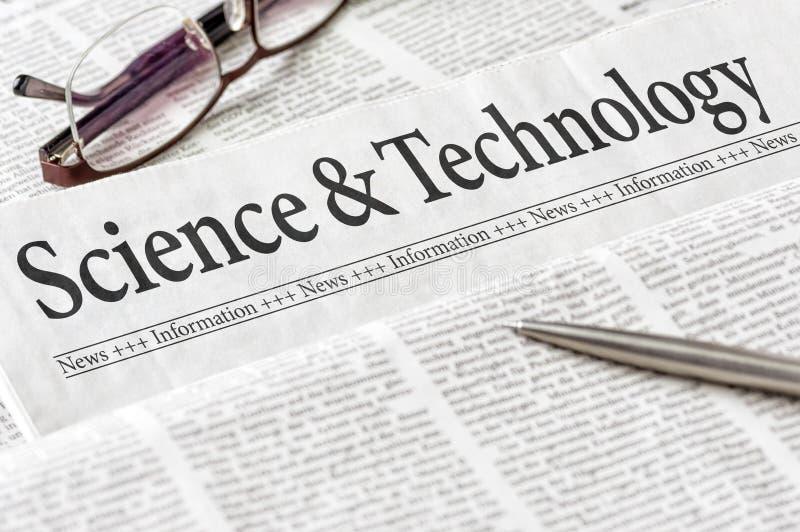 Zeitung mit dem Schlagzeile Wissenschaft und Technik lizenzfreie stockfotografie