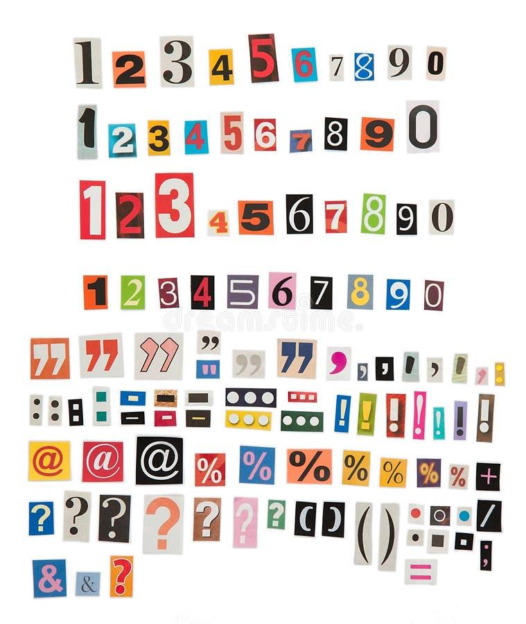 Zeitungszahlen und -symbole lizenzfreies stockbild