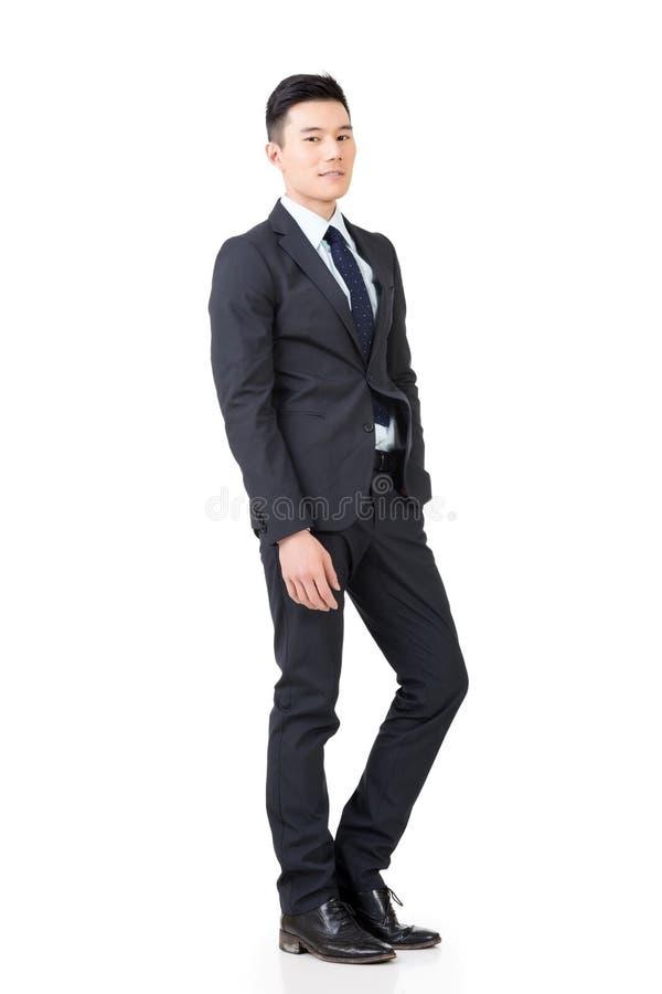 Zekere Aziatische zakenman stock afbeeldingen