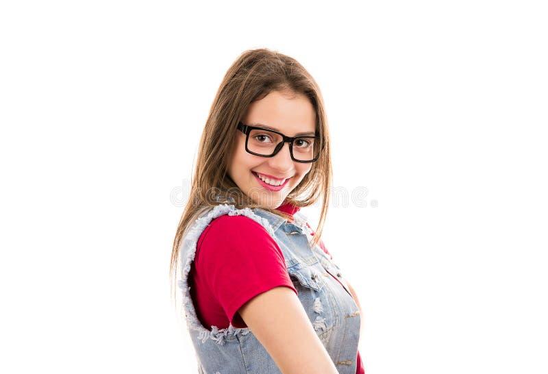 Zekere gelukkige vrouw in modieuze uitrusting stock afbeelding