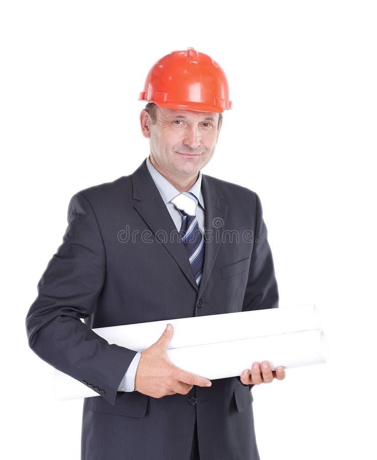 Zekere ingenieur met de tekeningen van het nieuwe project stock foto's
