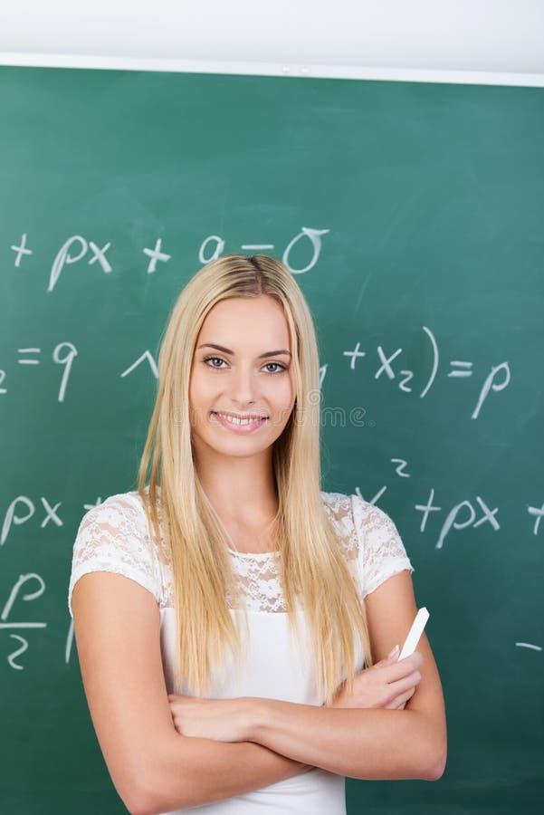 Zekere jonge vrouwelijke student royalty-vrije stock foto