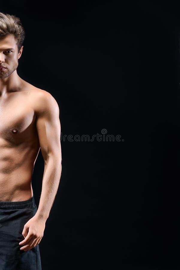 Zekere kerel met naakt opgeleid lichaam royalty-vrije stock foto's
