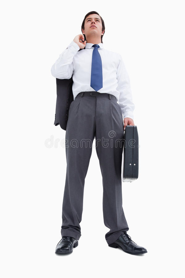Zekere kleinhandelaar met koffer en jasje stock fotografie