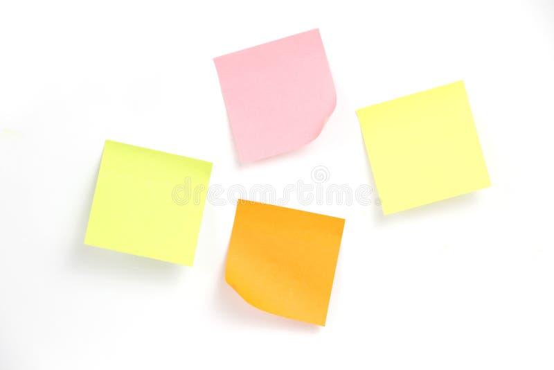 Zelfklevende/Kleverige Nota's over wit stock fotografie