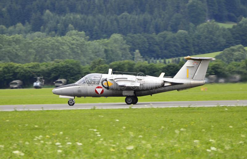 Airshow, Airpower 11. Zeltweg, Styria, Austria - July 01, 2011: Saab 105 fighter jet from Austrian airforce by public airshow named airpower 11 royalty free stock photos