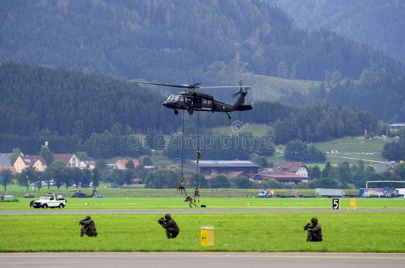 Airshow, Airpower 16,. Zeltweg, Styria, Austria - September 02, 2016: Field exercise with S-70 Black Hawk helicopter by public and entrance free airshow named stock images